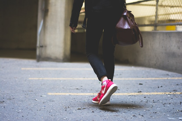 Person Walking in Red Shoes